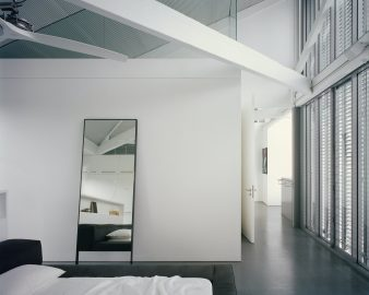 the-master-bedroom-has-a-view-back-across-the-courtyard-to-the-living-space-and-the-terrace-beyond